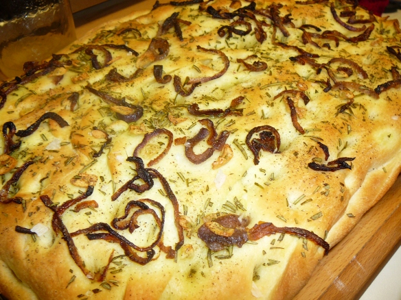 hot focaccia with fresh rosemary, carmelized red onions, garlic slices - topped with maldon sea salt and freshly cracked pepper