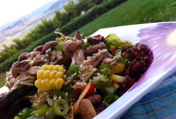 Asian Style Salad with shredded chicken on a bed of cooled red rice