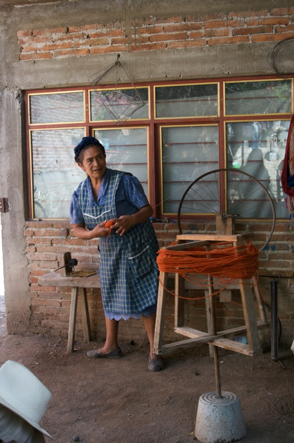 Filippa has lived with her husband's family ever since marrying 28 years ago - she has now started on a sewing business on a treadle sewing machine (with loans from En Via) to supplement the weaving income.  They might only sell 3 or 4 rugs per month.