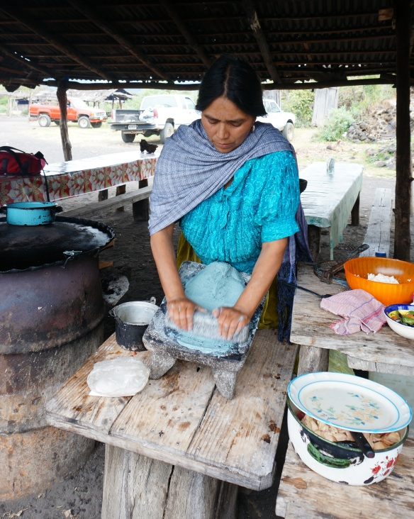 Maria, making us gorditas from blue corn flour - traditional methods and traditional clothing used in this village.