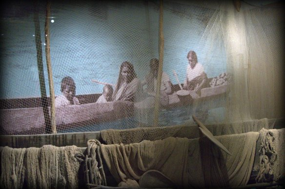 Typical indigenous fishing family in dugout canoe.