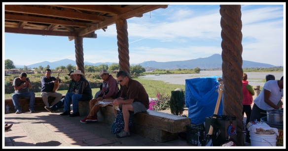 Waiting for the ferry boat to go over to Isla Janitzia, with local musicians.