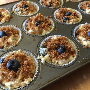 Pecan crumble gently pressed on - muffins are ready for the oven.