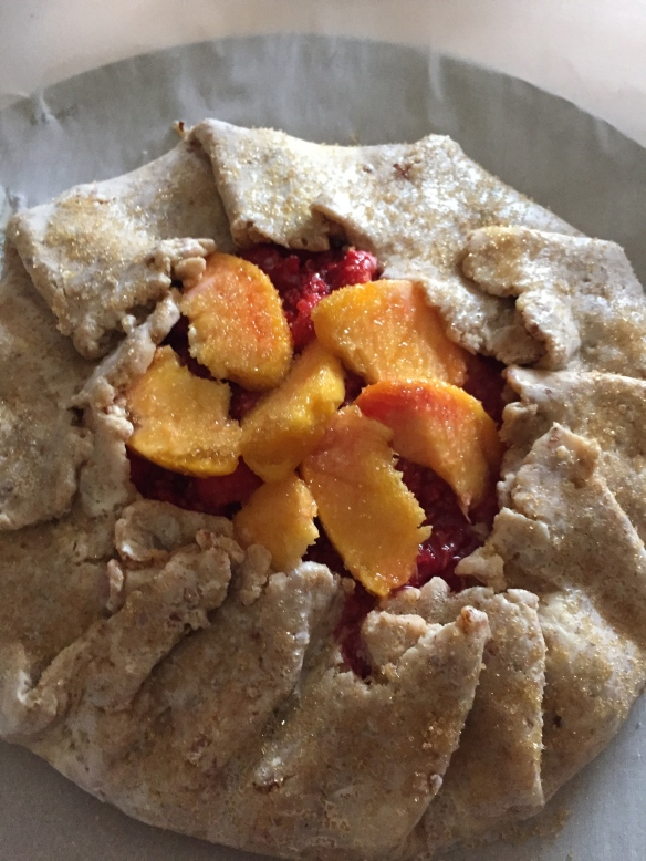 Ready for the oven, this raspberry peach galette looks delicious already.