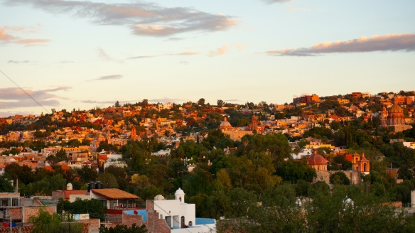 As the sun starts to set over San Miguel de Allende you can see the pastel colours and the amazing view from our rooftop deck.